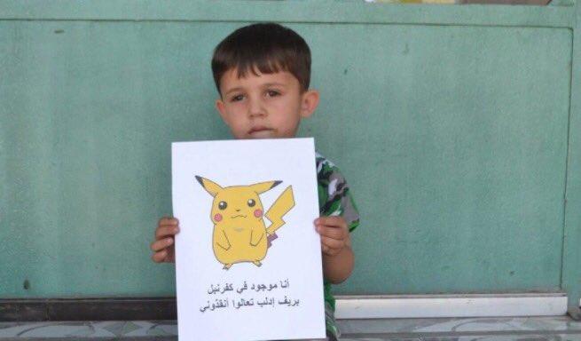 """صور مؤثرة لأطفال سوريين استغلوا لعبة """"البوكيمون"""" لجذب الأنظار لمعاناتهم من القصف"""